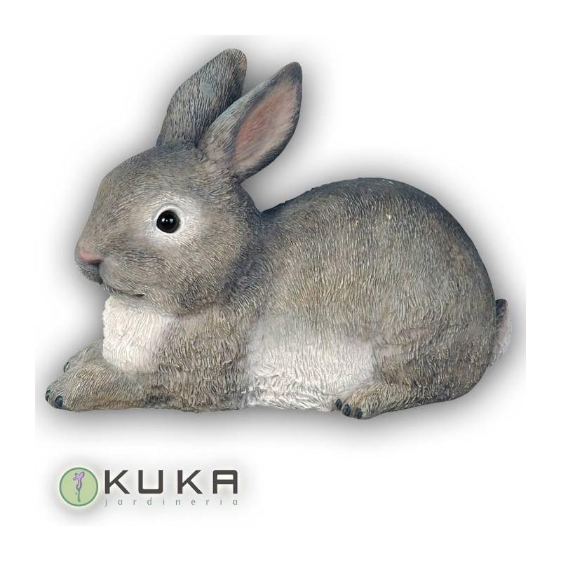 Figura conejo gris tumbado
